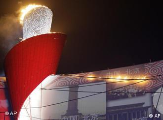 Chinese athlete Li Ning lights the Olympic flame