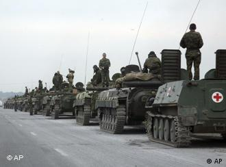 A column of Russian tanks rolls into South Ossetia on Aug. 8, 2008.