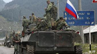 A column of Russian armored vehicles head towards the breakaway Georgian province of South Ossetia