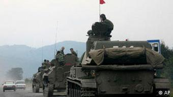 A column of Russian armored vehicles head towards the breakaway Georgian province of South Ossetia, in North Ossetia, Russia, Friday, Aug. 8, 2008.