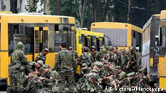 Georgian reserves waiting in front of busses to be transported to South Ossetia