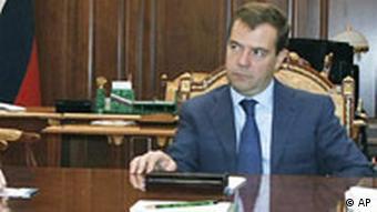 Medvedev sitting on a desk