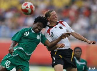 Kerstin Stegemann takes on a Nigerian player at the Beijing Olympics