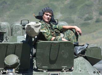 A Russian soldier sits aboard an armored vehicle on the road to the border of the Georgian breakaway region of South Ossetia