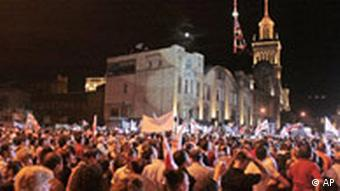 Demonstrators wave Georgian flags while protesting against what they call a Russian intervention in the breakaway Georgian enclave South Ossetia in Tbilisi, Sunday, Aug. 10, 2008.