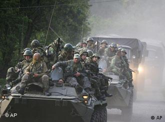 Russian troops ride atop armored vehicles and trucks near the village of Khurcha in Georgia's breakaway province of Abkhazia