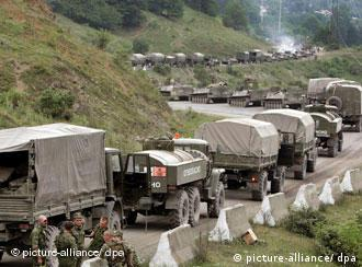 Russian army vehicles in a long line on a road in Georgia