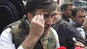Georgian President Mikhail Saakashvili talks to the media as he visits the town of Gori, Georgia