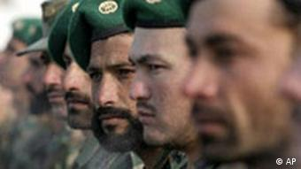 New Afghan National Army recruits stand at attention during their graduation ceremony