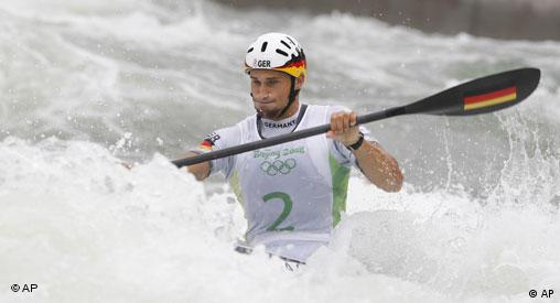 Germany's Alexander Grimm competes in the men's K1 kayak slalom at the Shunyi Olympic Rowing and Canoeing Park at the Beijing 2008 Olympics in Beijing, Monday, Aug. 11, 2008.