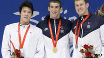 Gold medalist Michael Phelps flanked by two other medalists