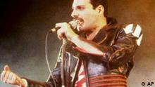 Freddie Mercury performing, lead singer of Queen,