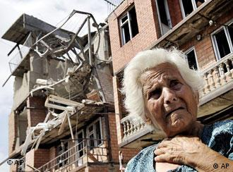 A Georgian woman cries in front of her destroyed apartment building in the city of Gori, Georgia, Wednesday, Aug. 13, 2008.