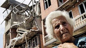A Georgian woman cries in front of her destroyed apartment building in the city of Gori, Georgia,