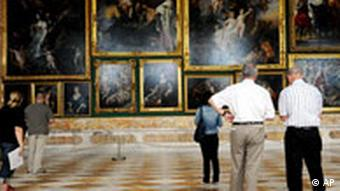 Visitors look at paintings in the Gallery of Sanssouci