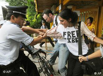 Foreign pro-Tibet activists are detained by Chinese police and security guards after they staged a protest near the main Olympics venue in Beijing Wednesday, Aug. 13, 2008