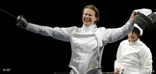 Britta Heidemann Fechten Olympia.jpg Germany's Britta Heidemann celebrates after defeating Roumania Ana Maria Branza, background, during the women's individual epee gold final at the Beijing 2008 Summer Olympics in Beijing, Wednesday, Aug. 13, 2008. (AP Photo/Andrew Medichini)