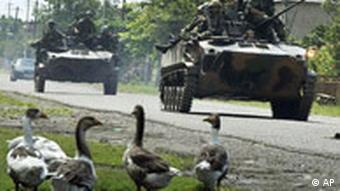 Russian troops ride on an armoured vehicles during outside of the Black Sea port of Poti