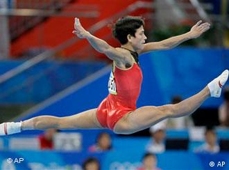 Germany's gymnast Oksana Chusovitina performs her floor routine during the women's gymnastics individual all-around competition at the Beijing 2008 Olympics
