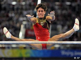 Germany's gymnast Oksana Chusovitina performs on the uneven bars during the women's gymnastics individual all-around finals at the Beijing 2008 Olympics
