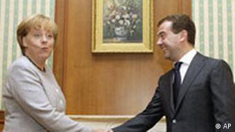 Russian President Dmitry Medvedev, right, shakes hands with German Chancellor Angela Merkel during their meeting at his residence in Sochi, a Black sea resort, Friday, Aug. 15, 2008. Merkel arrived in Russia on a one-day working visit. (AP Photo/Misha Japaridze)
