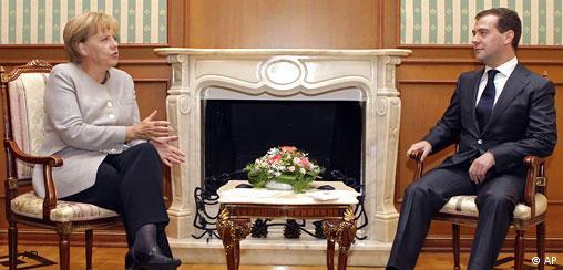 German Chancellor Angela Merkel talks with Russian President Dmitry Medvedev