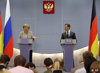 German Chancellor Angela Merkel looks at Russian President Dmitry Medvedev, during a joint press conference in the Black Sea resort city of Sochi, Friday, Aug. 15, 2008.
