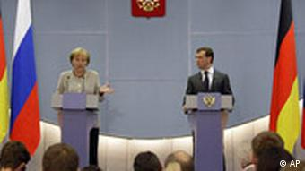 German Chancellor Angela Merkel, left, talks during a joint press conference with Russian President Dmitry Medvedev, right, in the Russian Black Sea resort city of Sochi, Friday, Aug. 15, 2008. Merkel said some of Russia's actions in Georgia have been disproportionate and the presence of Russian troops there is not sensible. (AP Photo/Misha Japaridze)