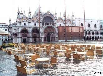 Water floods an outdoor cafe in St. Mark's square in Venice