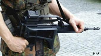 G36 Sturmgewehr Heckler and Koch G36 rifle held by German military poliecman, phot