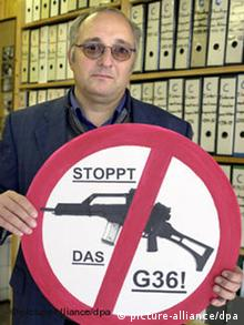 Juergen Graesslin with a sign saying Stop the G36