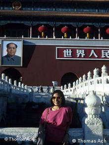 Photo of author in front of Beijing's Forbidden City with portrait of Mao in background