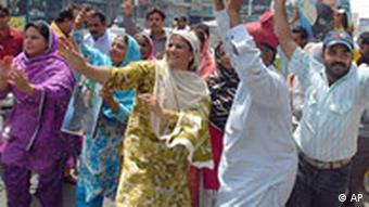 People dance in Multan after hearing the announcement that Musharraf will resign