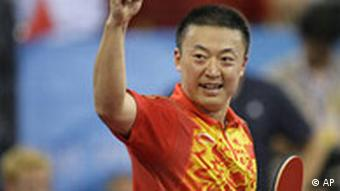 China's Ma Lin celebrates his match win against Germany's Timo Boll during the men's table tennis team competition gold medal round