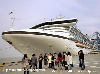 Tourists disembark cruise ship Princess Sapphire in Shanghai