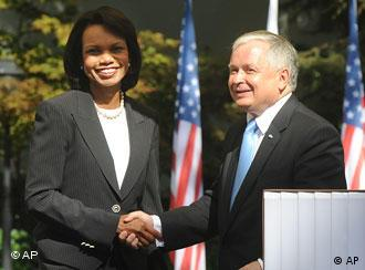 Former US Secretary of State Condoleezza Rice, left, and Polish President Lech Kaczynski shake hands after a meeting in Warsaw, Poland, Wednesday, Aug. 20, 2008.