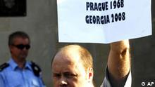 A man holds a placard during the protest against the occupation of Georgia by the Russian army in front of the Russian embassy in Prague on Thursday, Aug. 21, 2008. About a hundred demontrators drew parallels between the Russian occupation and the Soviet-led invasion of Czechoslovakia on August 21, 1968. (AP Photo/CTK, Jan Hrouda) ***SLOVAKIA OUT***