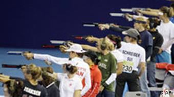 women pentathletes shooting air pistols