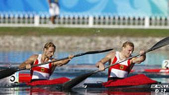 Germany's Andreas Ihle, left, and Martin Hollstein, right, celebrate after winning the kayak double K2 1000M men final race at the Beijing 2008 Olympics in Beijing.