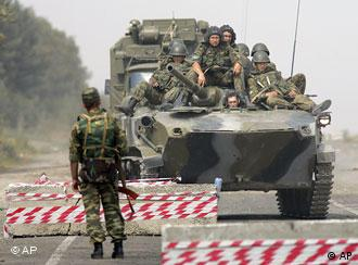 A Russian tank approaches a checkpoint in South Ossetia