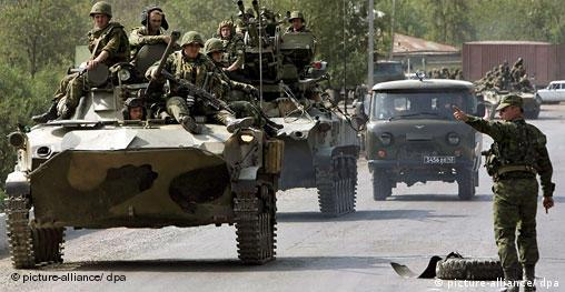 A column of Russian troops moves from Tskhinvali back to Russia near the village of Dzhava, South Ossetia