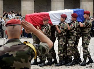 Coffins of French soldiers killed in Afghanistan are carried during a funeral ceremony at Les Invalides, in Paris, Thursday, Aug. 21, 2008.