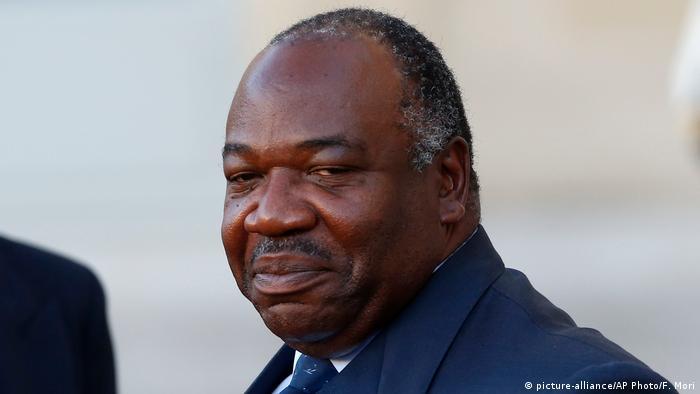 Gabon's President Ali Bongo looks slightly sideways towards the camera