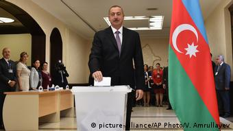 Azerbaijan voters back stronger powers for president | News | DW ...