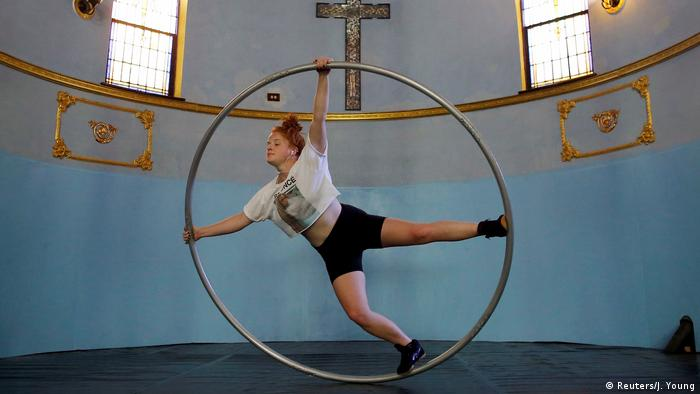 Aerial Emery trains on the cyr wheel at the Aloft Loft circus training and teaching school which was converted from a church in Chicago (Reuters/J. Young)