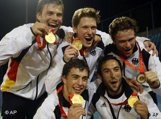 German hockey players show off their gold medals