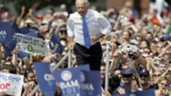 Democratic vice presidential running mate Sen. Joe Biden, D-Del., jogs out to meet Democratic presidential candidate Sen. Barack Obama, D-Ill., as they appear together outside the Old State Capitol Saturday, Aug. 23, 2008, in Springfield, Ill. (AP Photo/Jeff Roberson)