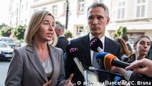 epa05558036 High Representative of the European Union (EU) for Foreign Affairs and Security Policy and Vice-President of the European Commission Federica Mogherini (C-L) welcomes Secretary General of the North Atlantic Treaty Organization (NATO) Jens Stoltenberg (C-R) answer media questions as they arrive for the Informal Meeting of the European Union (EU) Defence Ministers in Bratislava, Slovakia, 27 September 2016. EPA/CHRISTIAN BRUNA +++(c) dpa - Bildfunk+++