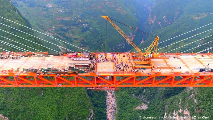 An aerial view of the Beipanjiang Bridge, the world's highest bridge, under construction over the Nizhu River