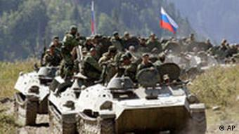 A column of Russian armored vehicles moving toward the border with North Ossetia